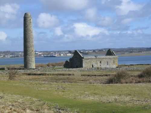 The round tower and the remains of one of the churches on Scattery Island